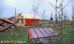 "Political activism? Sustainable energy production with, a.o., amorphous silicium solar panels during occupation of the ""second Bulderbos"" (""The Roaring Forest"") to prevent overambitious plans by Schiphol to become a ""Mainport"" in one of the most densely populated countries in the world. © 2001 P.J. Segaar"